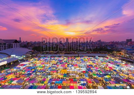 Top view multiple colour flea market rooftop with dramatic sunset sky background