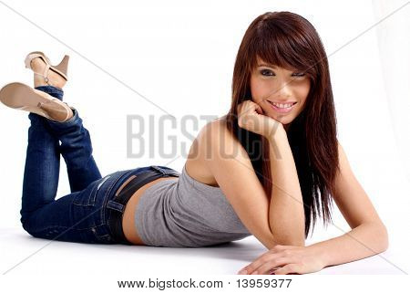fashion woman portrait where she is smiling on the floor over a white background