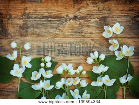 delicate jasmine branches lie on wooden planks