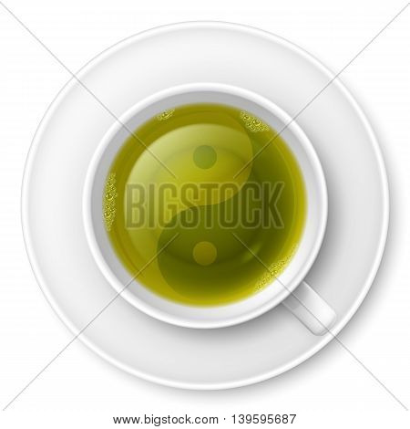 Cup of green tea with traditional Chinese Yin-Yang symbol