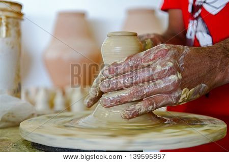 Traditional Pottery making, a village industry in Bahrain- Motion blurred image