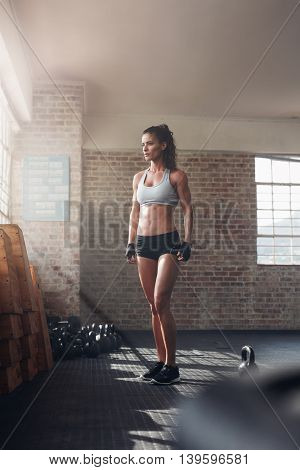 Strong Woman Standing In Crossfit Gym