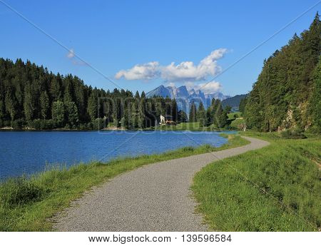 Travel destination Obersee Glarus Canton. Trail leading around the lake. Nature background.
