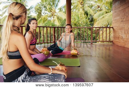Women In Yoga Class Taking Break