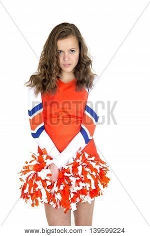Beautiful Teen Cheerleader Standing Holding Orange And White Pom-poms
