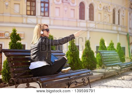 hipster girl with tablet listening music toning effect