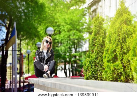 beauty hipster girl sitting in the park
