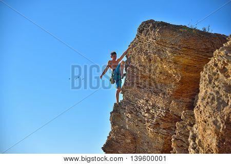 Extreme Climber Climbs On A Rock