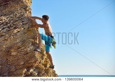 Man Climbing Up On Mountain