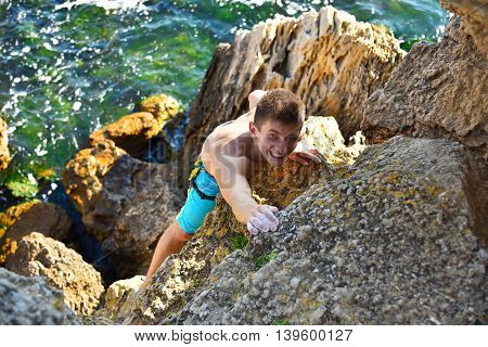 Man Climbing On A Rock
