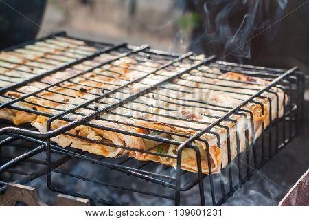 shawarma grilled burritos on the a grid.