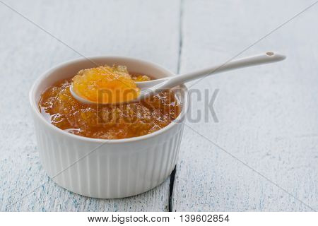Orange Jam In A White Mask With A Spoon