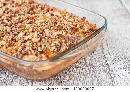 Pie With Orange Jam And Walnuts On A Wooden Background