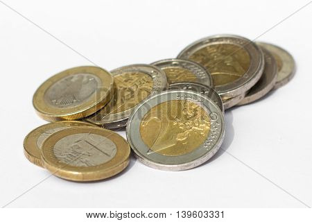 Money - Pile Of Euro Coins On White Background
