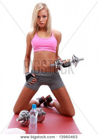 Sexy fitness girl is working out with weights