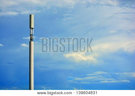 Monopole Disguised Cell Tower Against Blue Skies