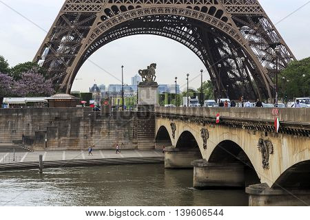 PARIS, FRANCE - MAY 12, 2015: Bridge of Jena connects the Champ de Mars and the Trocadero gardens. It is named after the town of Jena where Napoleon defeated the Prussian troops.