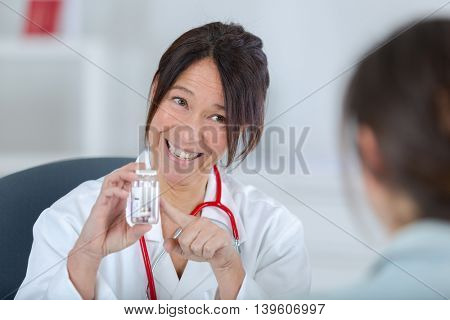 doctor proposing tablets to patient