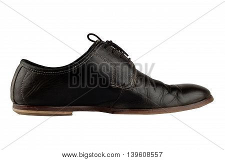 Horizontal side view of an elegant old black leather shoe isolated on white background