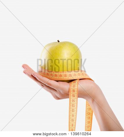 Best choice for your health. Close up of apple in hand of pleasant woman holding it on white background