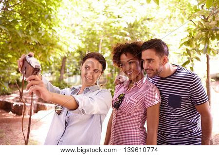 Young Threesome Posing For A Selfie