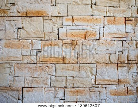 Detail of a decorative wall of jagged limestone tiles of different sizes