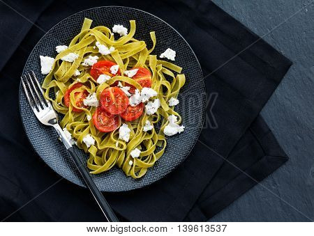 Pasta with fried tomatoes and feta cheese