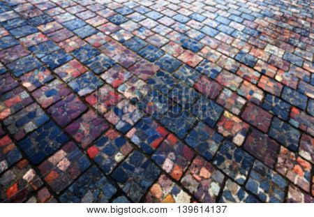 stone tiles on the road for pedestrian traffic, close-up, defocused