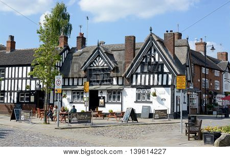 SANDBACH, UK - MAY 29, 2016: Sandbach market town centre, traditional black and white pub, Sandbach, Cheshire, UK