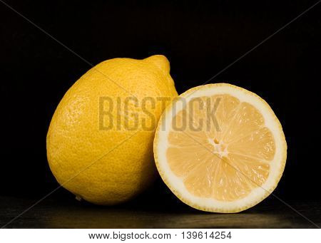 Ripe two lemons on a black background