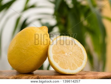 Ripe two lemons on a summer background