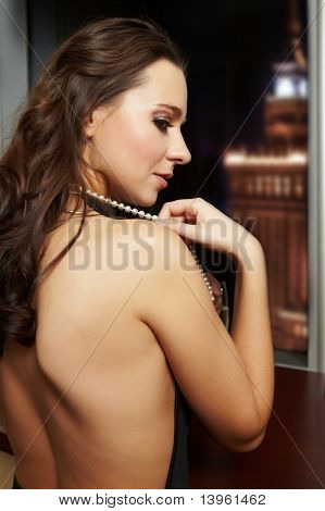Beautiful woman in front of night city