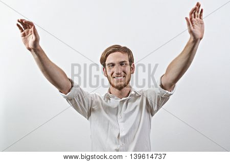 Smiling Joyful, Very Happy Young Man in White Shirt, Arms Raised