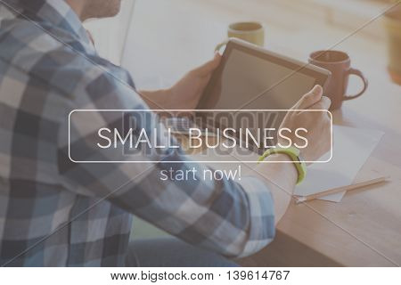 Digital. Inspirational typographic quote about small business with cropped image of man using digital tablet in a background
