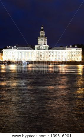 View of University Embankment and Cabinet of curiosities at night in St.Petersburg Russia.