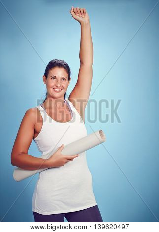 Cheering Young Yoga Woman With Excercise Mat