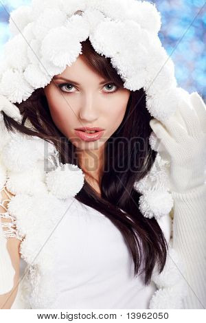 Portrait of a Winter woman. Pom-pon hat