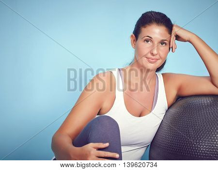Smiling Young Yoga Woman With Excercise Ball