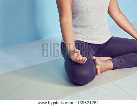 Faceless Yoga Woman Sitting In Lotus Position