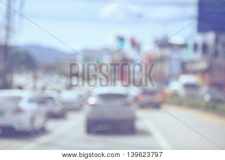Blur Image. Car On The Road While Stop And Waiting In Traffic Light. Retro And Vintage Style