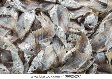 Top view stack of fish skeleton after filleting. Food background