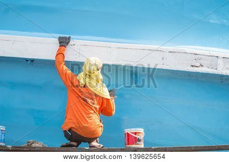 Phuket, Thailand - June 4 : Unidentified Women Workers Repairing And Painting On Wooden Fishing Boat