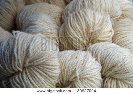 Natural white wool yarn balls on  display