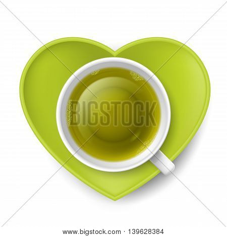 Cup of green tea with saucer in shape of heart