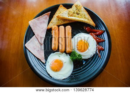Breakfast With Fried Eggs, Bacon, Sausages And Toasts.