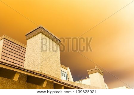 Wildfire orange smoke passing over residence in the city