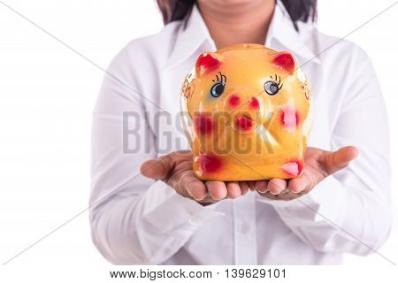 Woman Holding Yellow Piggy Bank Isolated On White