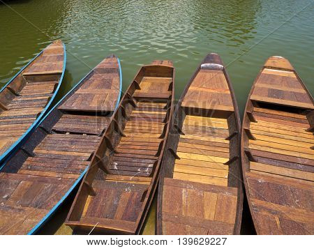Small Wooden boat float in the lake