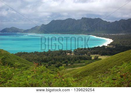The azure blue ocean of Waimanalo Bay lined by white-sand beach on Oahu, Hawaii
