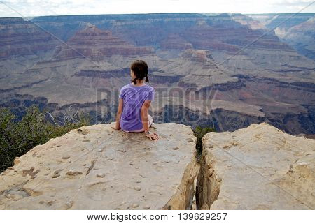girl taking in the panorama of Grand Canyon on South rim trail